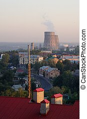 City sunrise landscape with steam-pipes in Russia