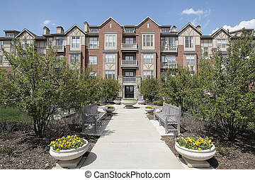 Brick townhouse in suburbs - Three story brick condominium...