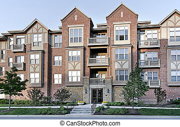 Three story tudor style condominium with stone entry
