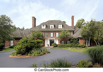 Large brick home - Large luxury brick home with circular...