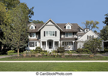 Luxury home in suburbs with circular driveway