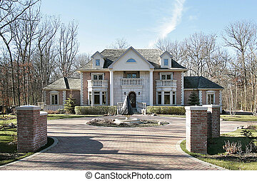 Large brick home - Large luxury home with shingle roof and...