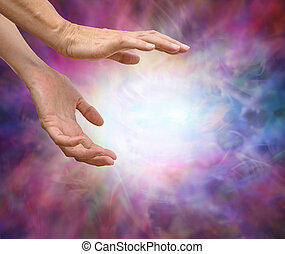 Sensing Reiki Energy - Pair of female hands reaching into...