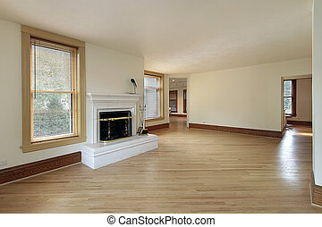 Living room in remodeled home with fireplace