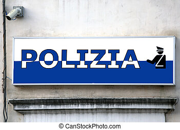 sign over an police station in an Italian town - large sign...