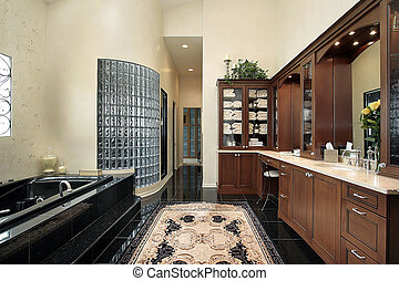 Master bath with black tub