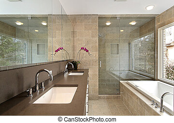 Master bath in luxury home - Master bath in modern home with...