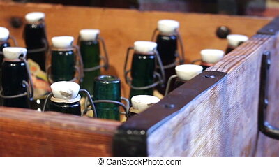Green bottles with a vintage cap in wooden box
