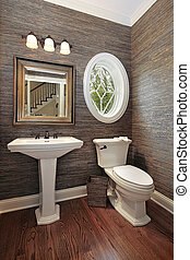 Powder room in luxury home with circular window