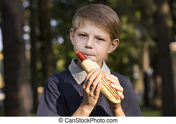 boy eating a hot dog