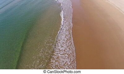 Waves Crashing on Beach, aerial view movement back