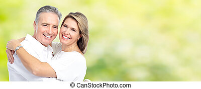 Happy senior couple. - Happy senior loving couple over green...