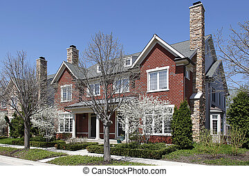 Townhouses in early spring with blooming trees - Townhouse...