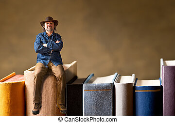 man sitting on the books - man with hat sitting on the book