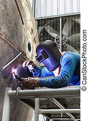 Welding sparks of welders in the industry