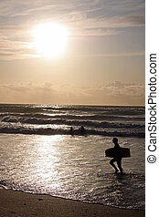 Surfer with surf board on beach the beach with sun - Surfer...