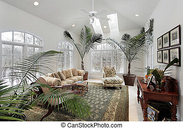 Sun room in luxury home with ferns