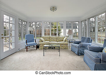 Sunroom with patio view - Sunroom porch with door leading to...