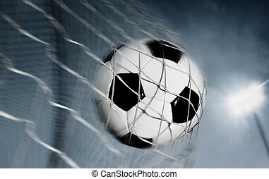 Soccer ball kicked into the back of a goal