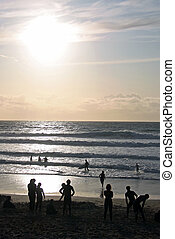 People, swimmers and a surfer on the beach - People,...