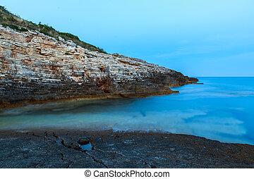 Beautiful rocks and sea. Sunrise over the sea near Rt...