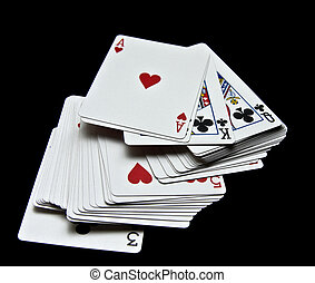 Playing cards - Displays various playing cards on a black...