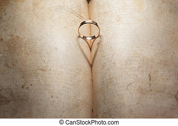 Wedding Ring and heart shaped shadow over a book