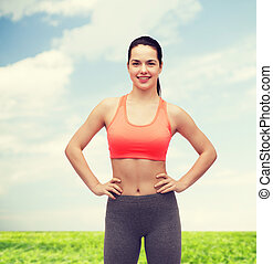 smiling teenage girl in sportswear - fitness and diet...