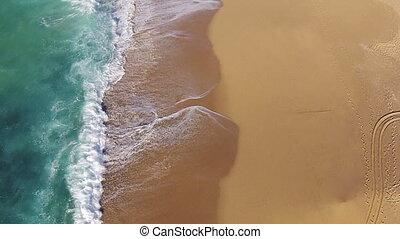 Waves Crashing on Beach, aerial view from quadcopter