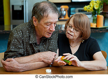 Senior Couple at Home Discussing Medication