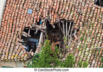 View of a broken roof of a house in Santo Domingo de la...