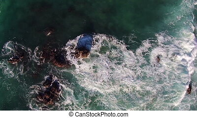 Waves Crashing on Rocks, aerial view from quadcopter
