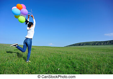 young asian woman with balloons - oung asian woman running...