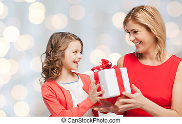 happy mother and daughter with gift box - people, holidays,...