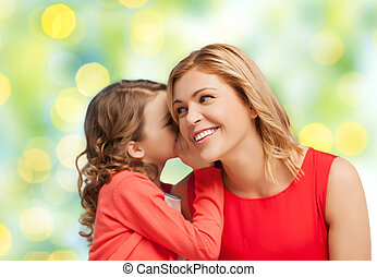 happy daughter whispering gossip to her mother - people,...