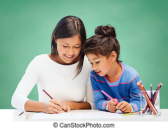 happy teacher and little school girl drawing - education,...