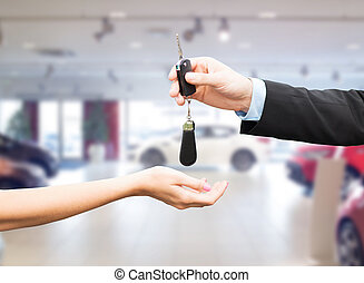 close up of customer and salesman with car key - auto...