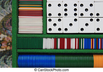 gambling concept - table game set, fishes and dominoes...