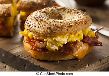Hearty Breakfast Sandwich on a Bagel with Egg Bacon and...