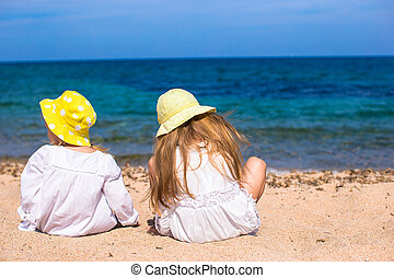Adorable cute girls on white beach during vacation - Little...