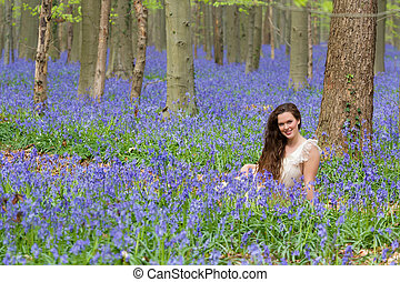 Smiling in spring forest - Pretty young woman with long hair...