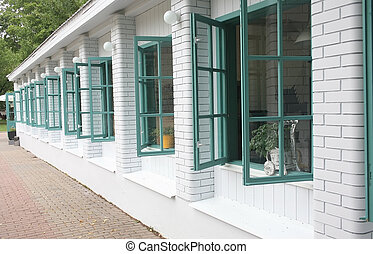 brick wall with open windows - white brick wall with open...