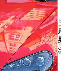 reflections of buildings on cowl of car - reflections of...