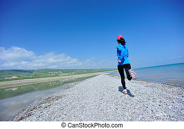 Runner athlete running seaside - Runner athlete running on...