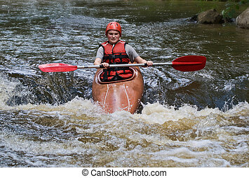 teenage girl white water kayaking - great image of a...