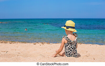 Adorable little girl have fun at tropical beach - Adorable...