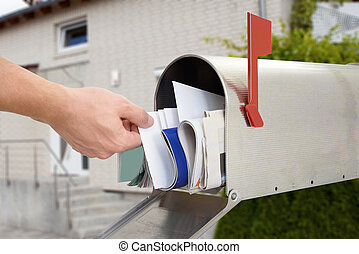 Man Taking Letter From Mailbox - Close-up Of Mans Hand...