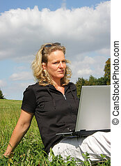 thoughtful woman with laptop