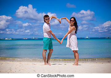 Romantic couple enjoy vacation on tropical white beach