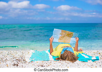 Adorable little girl with map of island on tropical beach -...